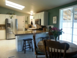 Long view of a remodeled kitchen by Ackerman Construction