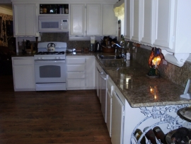 Long view of a counter and floor in a kitchen remodeled by Ackerman Construction
