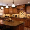 Photo of a dark wood kitchen remodeled by Ackerman Construction