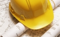 Photo of a hard hat on construction plans